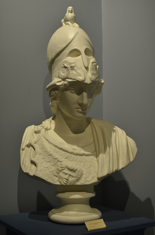 Cast based on the head known as the Athena Medici (once in the Medici Collection and now in the Louvre Museum in Paris). The sculpture in white marble probably copies the bronze Athena Promachos by Pheidias installed near the center of the Athenian Acropolis in 456 BCE. Its height was said to be so great that the tip of the spear Athena carried in her right hand was said to be visible from Sounion.